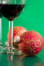 Glasses of wine and Christmas balls Stock Image