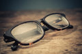 Glasses on wooden table Royalty Free Stock Photos