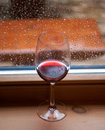 Glassof red wine on the windowsill Stock Photos