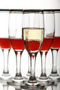 Glasswine with red wine on mirror table Stock Photography