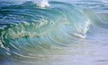 Glassy blue barreling wave photograph of a smooth beach break Royalty Free Stock Images