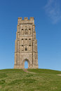 Glastonbury tor somerset england which features the roofless st michael s tower it is a scheduled ancient monument at the location Stock Photography