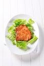 Glazed pork chop on lettuce leaves Royalty Free Stock Photo