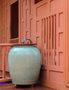 Glazed pottery for water storage on thai wooden house terrace Stock Photography