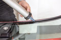 Glazier applying rubber sealing to windscreen windshield in garage Stock Photography