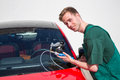 Glazier repairing windscreen after stone chipping damage windshield on a car Royalty Free Stock Photos