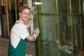 Glazier in workshop handling glass Royalty Free Stock Photo