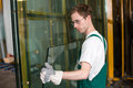 Glazier in workshop handling glass worker s warehouse or storage Stock Photos