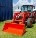 New Farm Tractor with bucket attachment. Royalty Free Stock Photo