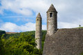 Glendalough co wicklow the round tower and small tower in Royalty Free Stock Photo