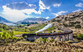 Glenfinnan Railway Viaduct in Scotland with the Jacobite steam train against sunset over lake Royalty Free Stock Photo