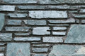 Glimmering slate wall close up image of gray of piled up stone slabs Stock Photography