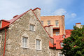 Glimpse of old quebec city canada houses made stone with red roofs in the Stock Photography