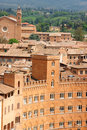 Glimpse of siena in italy with palazzo sansedoni piazza del campo and the ancient tiled roofs the old town the background the Stock Photography