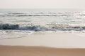Glistening waves on beach