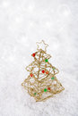 Glitter christmas tree decoration on white snow background shallow dof Stock Image