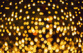 Glitter lights background. Holiday bokeh texture. Dark gold and black Royalty Free Stock Photo