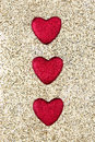 Glitter shaped hearts on a gold glitter background Stock Images