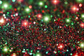 Glitter and stars background red green with bokeh Royalty Free Stock Image