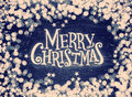 Glitter stars and defocused lights on grunge wood with Merry Christmas text. Retro tinted Royalty Free Stock Photo