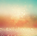Glitter vintage lights background. gold, silver, blue and white. abstract blurred image. Royalty Free Stock Photo