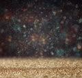 Glitter vintage lights background light gold and black defocused Stock Images