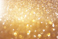 Glitter vintage lights background. light gold and black. defocused.