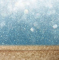 Glitter vintage lights background light gold and blue defocused Royalty Free Stock Photography