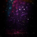 Glitter vintage lights background. light silver, purple, blue, gold and black. defocused. Royalty Free Stock Photo
