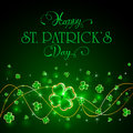Glittering clover leaves on green Patricks Day background