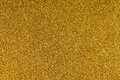 Glittering gold paper sheet texture background. Sparkling golden yellow pattern Royalty Free Stock Photo