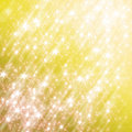 Glittering yellow background with stars Stock Photo