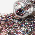 Glitters close up view of bottle full of colorful Stock Photo