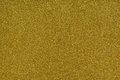 Glittery texture. Gold glitter paper Royalty Free Stock Photo