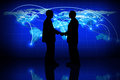 Global business silhouette of a partner agreement in a concept Royalty Free Stock Image