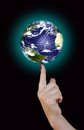 Global business strategy earth on top of the finger Royalty Free Stock Image