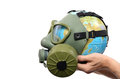 Global earth pollution and environmental concept globe with gas mask isolated Stock Images