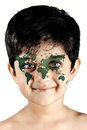 Global face young kid with the world painted on the Royalty Free Stock Photo