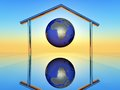 Global planet earth inside a metallic home shape Royalty Free Stock Image