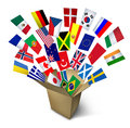Global shipping and freight services and worldwide delivery transport with an open cardboard cargo box and flags from around the Stock Photography