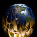 Global warming planet earth on fire with flames below and around it north america and and middle america visible Stock Photography