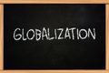 Globalization business concept the words written with chalk on blackboard Royalty Free Stock Photos