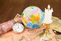 The globe ancient cards with a pocket watch and a candle Royalty Free Stock Image