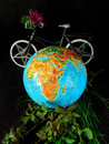 Globe and a bicycle. Travel concept. Environment concept Royalty Free Stock Photo