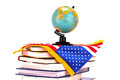 Globe, books and American flag Royalty Free Stock Photo
