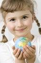 Globe on child hands Royalty Free Stock Photo