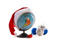Globe in a Christmas cap Stock Photos
