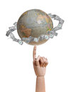 Globe with dollars on wooden finger Stock Images