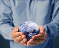 Globe earth in human hand businessmen Stock Images