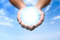 Globe energy in your hands sky background Royalty Free Stock Photography